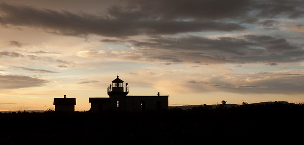 Point No Point lighthouse at sunset with window washer.