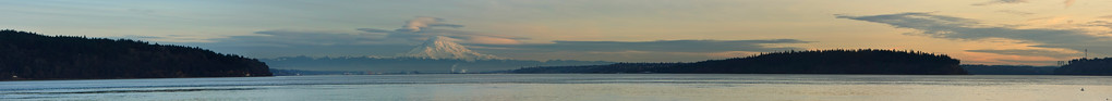 """Panoramic view of Mount Rainier and Puget Sound from near Gig Harbor.  Tacoma shipyard visible along shoreline below Mount Rainier.  Narrows Bridge visible on extreme right. Note: This is a large, stitched image.  If printed 12"""" high, will measure 12' in length.   If interested, please send me an email for details."""