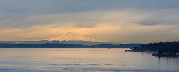 Evening light on Mount Rainier, Seattle in foreground.