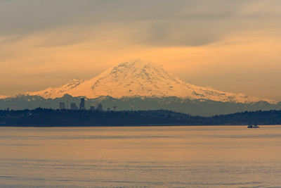 Evening light on Mount Rainier, Seattle in foreground.