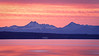 Edmonds, Marina Beach - Colorful sunset over the Olympic Mountains with a ferry boat passing in the foreground