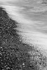 Edmonds, Beach - Abstract of waves impacting shore of beach, black and white