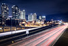 Bellevue, Downtown - Traffic on 405 in motion with skyline at night