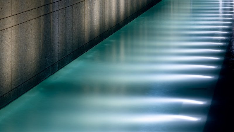Bellevue, Downtown Park - Water feature illuminated at night against a concrete wall