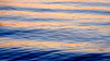 Everett, Howarth Park - Alternating patterns of blue and orange in the waves at sunset