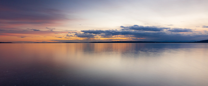 Edmonds, Marina Beach Park - Rainbow colors at sunset with calm water, panoramic