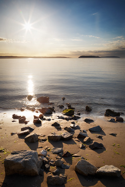 Everett, Howarth Park - Sunset over a group of rocks on a clear day