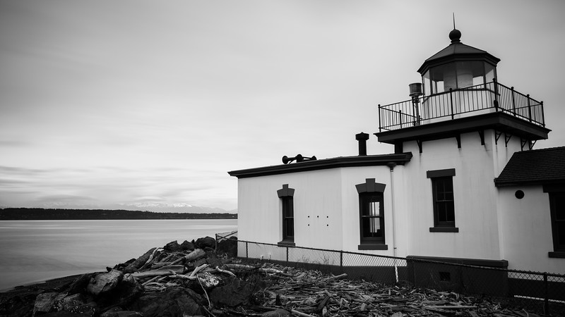Seattle, Discovery - Lighthouse along shore, long exposure black and white