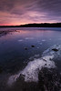 Redmond, Idylwood - Colorful sunrise over lake with ice in foreground