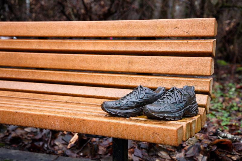 Bothell, Bothell Landing - Bronze shoe sculpture on park bench
