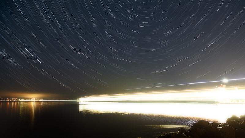 Mukilteo, Beach - Star trails with ferry boat departing Mukilteo and transiting strait