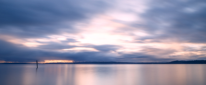 Edmonds, Beach - Long exposure view of colorful moving clouds at sunset