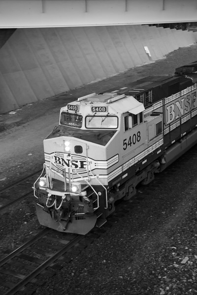 Seattle, Waterfront - BNSF locomotive in motion, bw