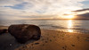 Edmonds, Marina Beach Park - Log at with waves and colorful sunset