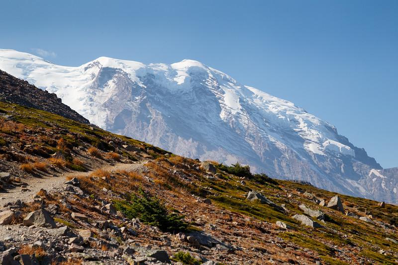 Rainier, Sunrise - Trail leading towards the summit of Burroughs Mountain with Mt. Rainier peeking above the ridge