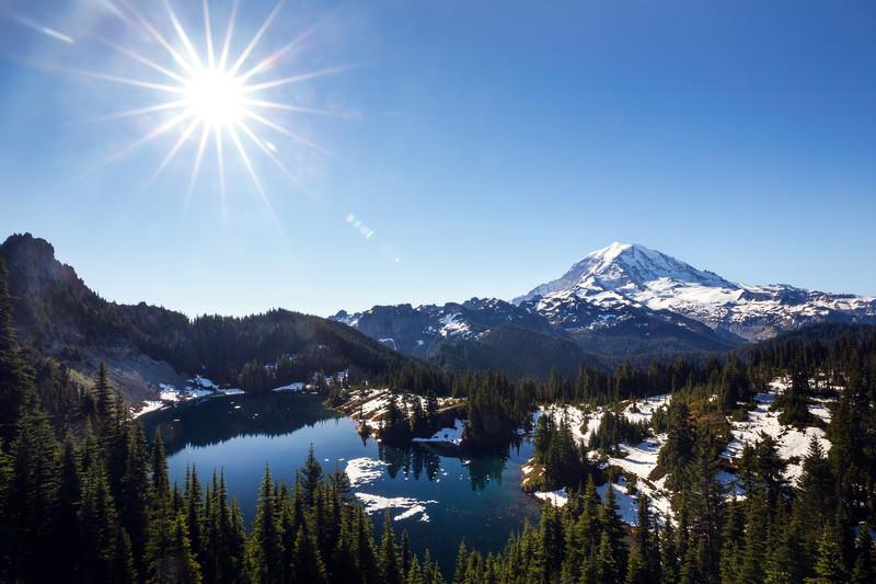 Rainier, Tolmie - Eunice Lake and Rainier from above with sun star