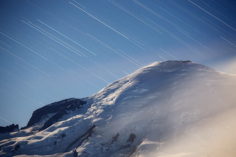 Rainier, Sunrise - Star trails over a Rainier lit by the moon out of frame