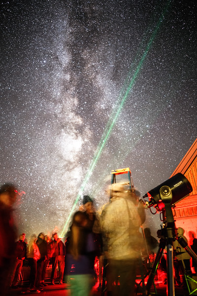 Rainier, Paradise - People gathered around telescopes with red lights and laser pointer as part of a star party under Milky Way