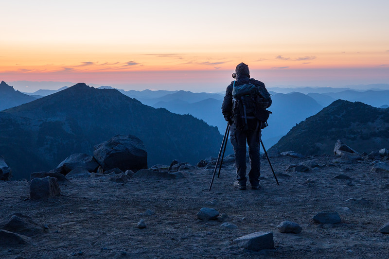 Rainier, Sunrise - Photographer overlooking ridge and distant sunset