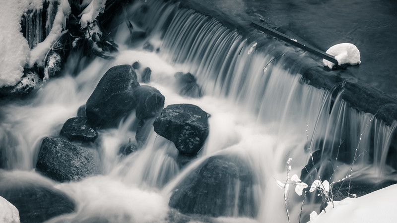Stevens Pass, Lanham Lake - Flowing waterfall over a log in long exposure, black and white