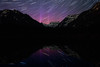 Snoqualmie Pass, Gold Creek Pond - Soft pink aurora with star trails over the pond, with reflection