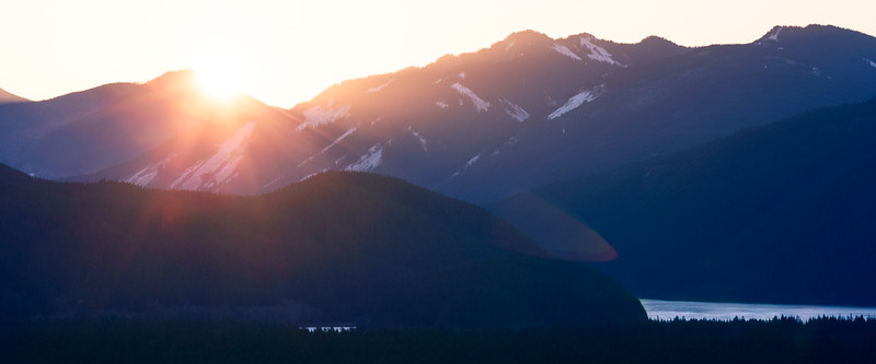 North Bend, Rattlesnake - First ray of sun peeks out over distant mountain