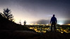 North Bend, Rattlesnake - Man on ledge overlooking brightly lit valley