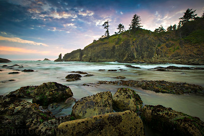 Sunset at the Second Beach at La Push in Olympic National Park. The famous beach is known for its stone haystacks, tide pools and natural bridge. Many camp along the Pacific Ocean to take in the setting western sun and cool sea breeze. Rocks and boulders create tide pools where starfish, hermit crabs and other sea creatures call home.  Photo by Kyle Spradley | © Kyle Spradley Photography | www.kspradleyphoto.com
