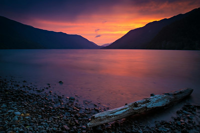 Sunset on Lake Crescent during a summer evening in Olympic National Park. The glacier-carved lake is a favorite spot for vacationers for kayaking, fishing and swimming in the cool, blue waters. This view is from nearby Lake Crescent Lodge looking west.  Photo by Kyle Spradley | © Kyle Spradley Photography | www.kspradleyphoto.com