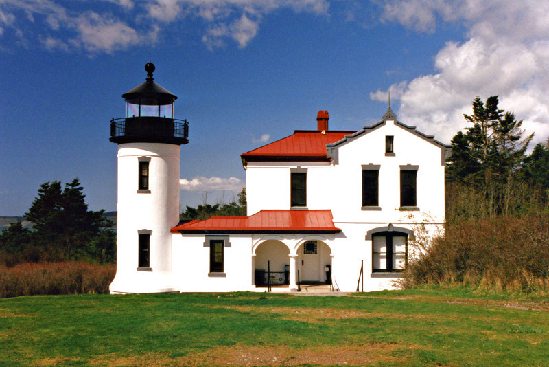 In 1903 a new lighthouse designed by the famous lighthouse architect Carl Leick was built.  The new lighthouse was a unique Spanish style building made with 18 inch thick brick walls covered with stucco.  A fourth Order Fresnel lens was placed in the lantern and lit on June 25, 1903.  The original lighthouse continued to serve as a medical center and quarters for non-commissioned officers.  It was torn down in 1927 and the timers were used to build a home on Useless Bay.