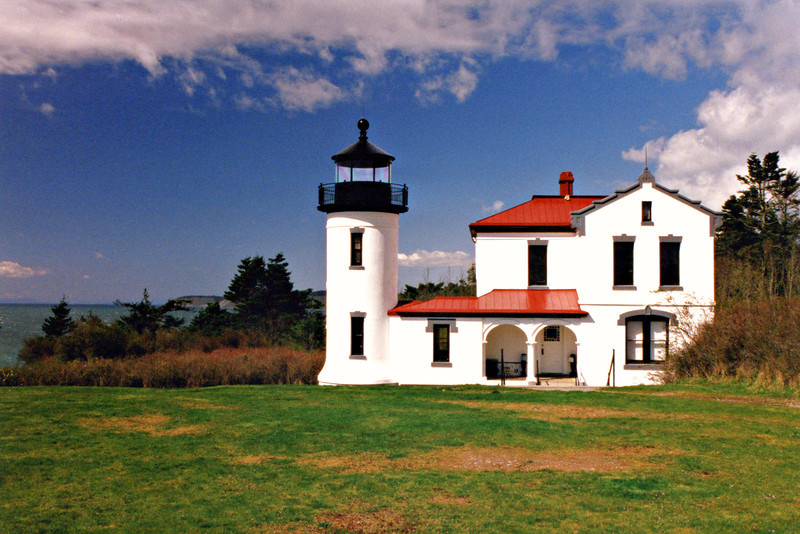 For a brief time during World War II Fort Casey was activated and the lighthouse was converted to officer housing.  In the 1950's Washington State Parks received 100 acres of the fort area including the lighthouse.  The lighthouse underwent a restoration and a new lantern was placed atop the tower.  In 1962 the old Fourth Order lens from the Alki Point Lighthouse was obtained and displayed inside the lighthouse.  The lighthouse and fort are maintained by the state and Washington State University and remains open to the public.