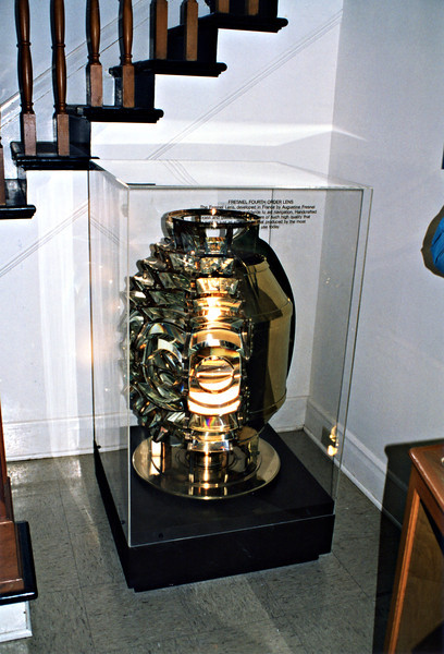 **A Fourth Order Fresnel originally located at the Alki Point Lighthouse on display at Admiralty Head**<br /> In 1897 the government purchased 123 acres adjacent to the lighthouse reservation for $7,200 to build the Fort Casey military complex to guard the entrance to Admiralty Inlet.  When the Army decided the lighthouse stood in a location where it wished to build a gun emplacement, the lighthouse was moved ½ mile to the north.