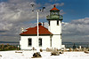 In the early 20th century as Seattle's marine commerce burgeoned, the Light House Service recognized the need for a full light station on Alki Point.  They purchased 1½ acres at the point from Edmund Hanson for $9,000 in 1910.  Hanson moved his family south to California.