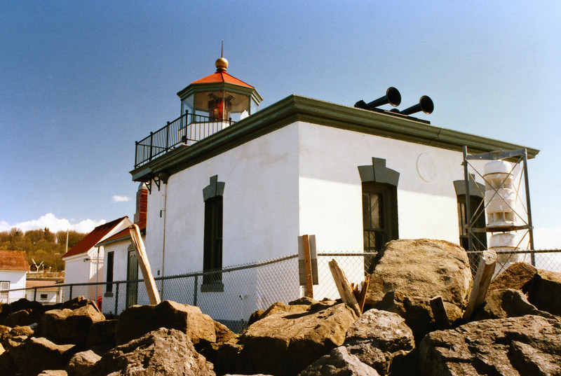 In 1886 the Lighthouse Board decided to replace the fog bell with a steam whistle and erected a building to house a caloric engine.  The whistle went into operation in February 1887 and the old fog bell was moved to the Warrior Rock Lighthouse in the Columbia River.  In 1906 a new fog signal building was attached to the west side of the tower.  The new fog signal was provided by two Daboll trumpets operated by compressed air provided by diesel engines.  In June 1944 a diaphragm air horn replaced the Daboll trumpets.