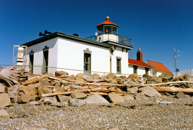 A squat 23 foot square brick lighthouse tower went into operation on November 1, 1881.  A pyramidal frame tower to house a 1,600 pound fog bell was also built.  The fog bell was transferred from the Cape Disappointment Light.   A 1½ story frame Keepers dwelling was built in the tower.