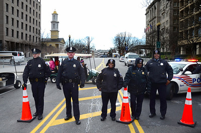 January 21, 10:21AM. Walking to the Mall, friendly roadblocks (an oxymoron?) kept pushing us farther from our goal. The President and his family had worshiped at St. John's Church, at left, just a short time before.
