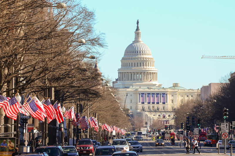 January 19, 12:50PM. Bedecked with flags, Pennsylvania Ave awaits the big parade.