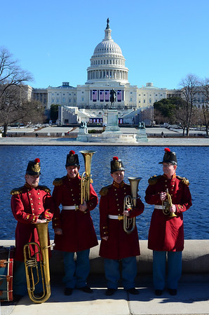 """Friday, January 18, 11:59PM. Reunited for some concerts at the Smithsonian during the Inaugural weekend, members of """"President Lincoln's Own,"""" - the band from the movie Lincoln - pose in front of the Capitol before performing """"We Are Coming Father Abraham, 600,000 More,"""" a chart-buster from 1862."""