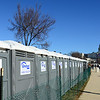 Friday, January 18, 11:56. The Porta-potties stilled smelled disinfected and were already forming a chemical barrier around the perimeter of the Mall.