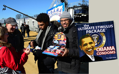 January 19, 12:57PM. Planning ahead for the post-inaugural-ball balls, a couple buys some Obama Condoms.