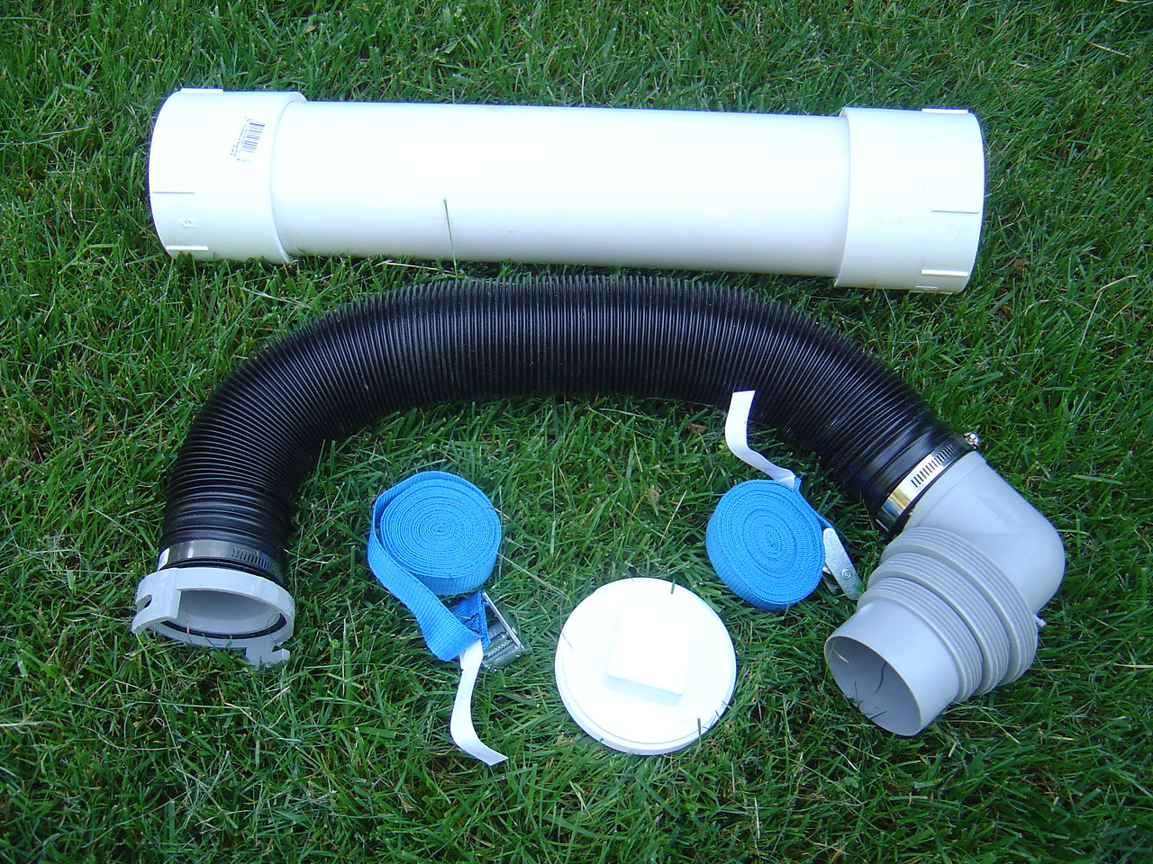 The parts - PVC pipe,  two slip/thread adapters, one end cap, straps (I ended up using a ratched type strap), and sewer hose with sewer drain adapter.