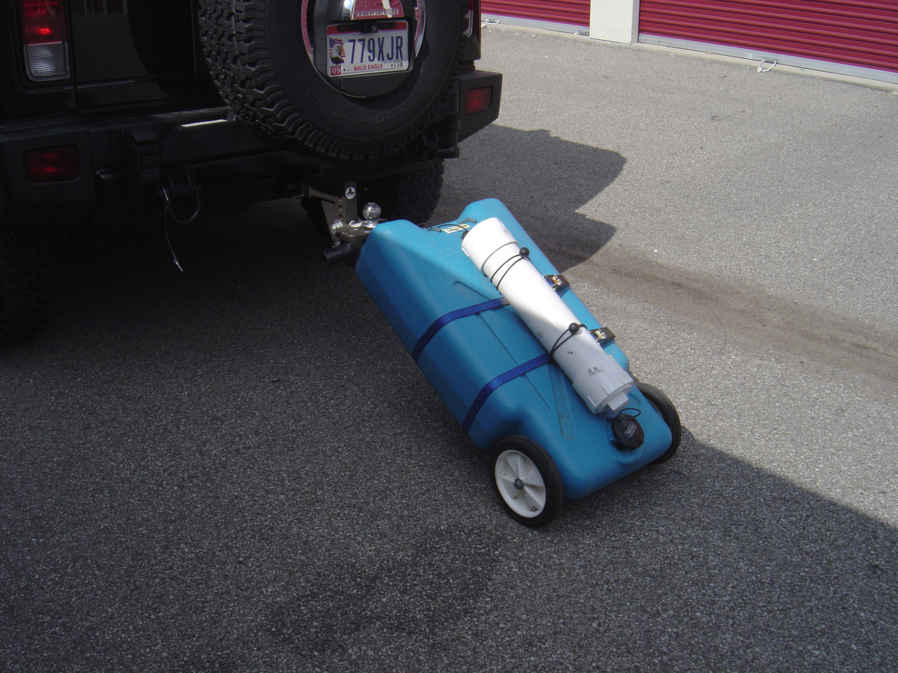This is the blue tote attached to the ball hitch when you need to haul it to and from the dump station.