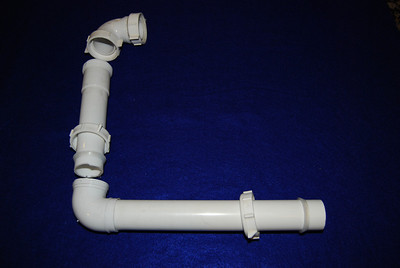 This show to components that make up the shower pipes.  They are Keeney Manufacturing company products and were purchased from Lowes and include (part No.): 1. 90 degree coupler elbow (30501wk) 2. one straight tube with the thread nut and plastic ring at the cut end (40-12wk) 3. one waste arm with a 90 degree elbow (104wk)