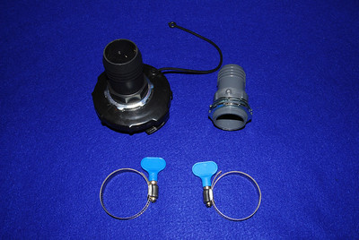 The adapter (the 1 1/2 hose adapter is connected to the gray water cover.