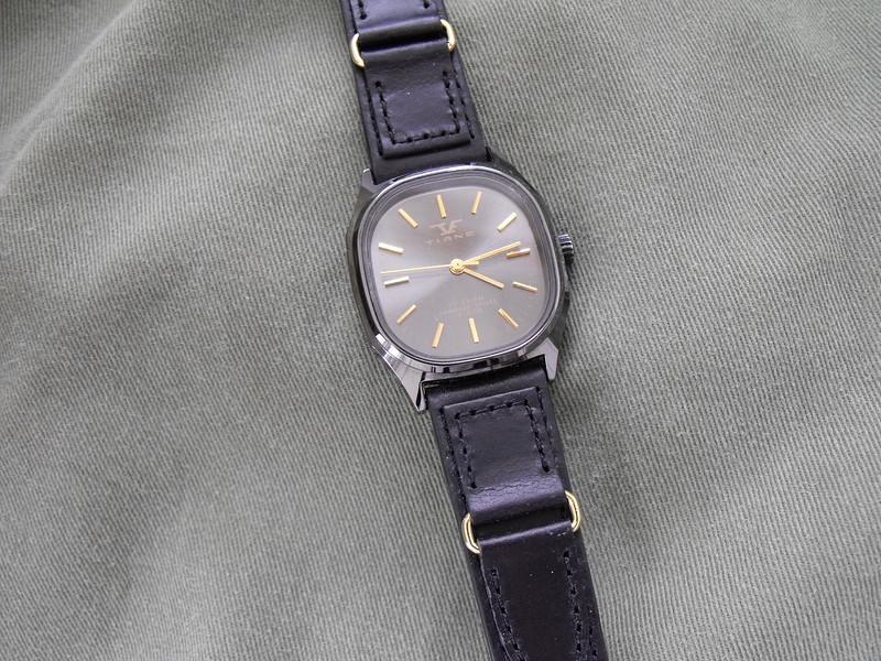 Tiane black dial