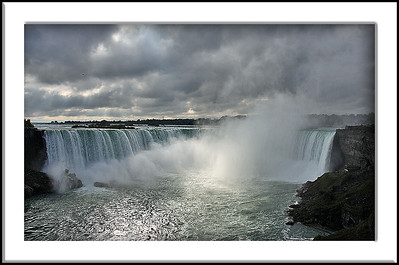 Niagara's Falls and lone sunbeam on a dark, cloudy, October morning.