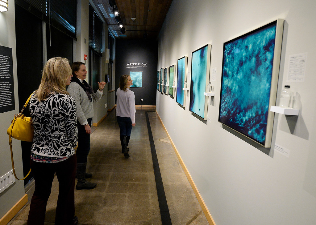 . LONGMONT, CO: January 30, 2019: Andrea Mathwich, left, Jennifer Henderson, and Ellen Hartman, look over the display.  Water Flow: Under the Colorado River, created  by  photographer, Kathleen Velo, is a new exhibit at the Longmont Museum.   (Photo by Cliff Grassmick/Staff Photographer)