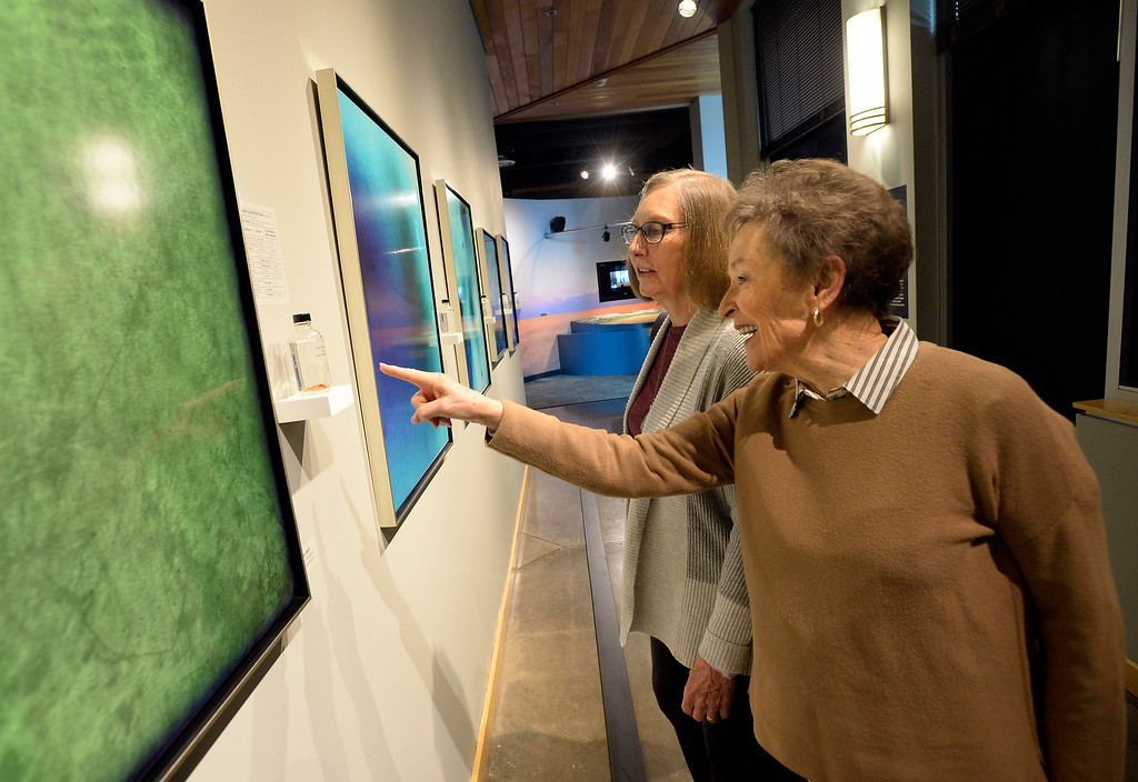 . LONGMONT, CO: January 30, 2019:  Kathy Oliver, front, and Mary Rushing, look at the images and how they were made. Water Flow: Under the Colorado River, created  by  photographer, Kathleen Velo, is a new exhibit at the Longmont Museum.   (Photo by Cliff Grassmick/Staff Photographer)