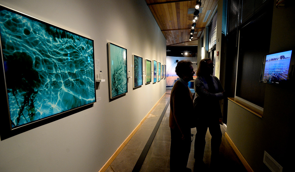 . LONGMONT, CO: January 30, 2019:    Kathy Oliver, left, and Mary Rushing, look at the images and how they were made. Water Flow: Under the Colorado River, created  by  photographer, Kathleen Velo, is a new exhibit at the Longmont Museum.   (Photo by Cliff Grassmick/Staff Photographer)