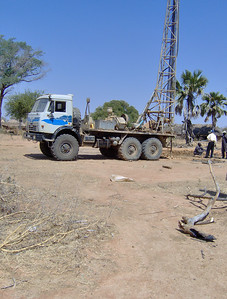 The drilling rig is a large and powerful construction machine. Without real roads, just getting equipment like this to remote village locations like Wunlang is a challenge.